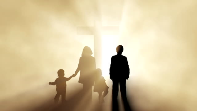 Christian family before a cross video