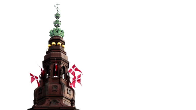 Christiansborg Palace Tower of the Danish Parliament, Christiansborg in Copenhagen, Denmark. Danish flag blowing in the wind. denmark stock videos & royalty-free footage