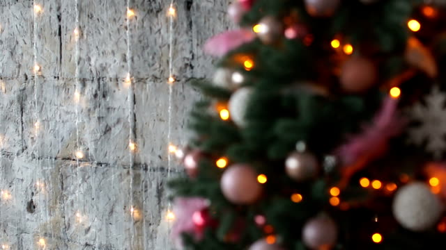 Christmas and new year decoration. Abstract blurred bokeh blinking garland. video