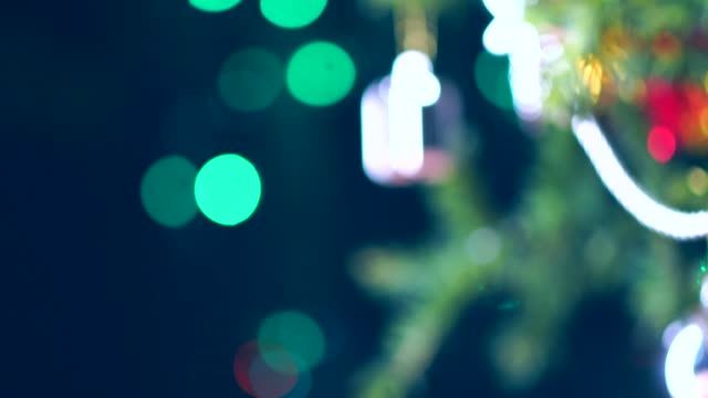christmas and new year decoration. abstract blurred bokeh holiday background. christmas tree lights twinkling. glowing background. 4k - christmas table video stock e b–roll