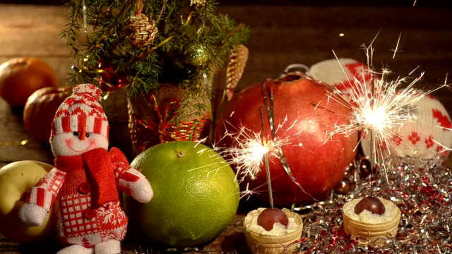 Christmas arrangement with fruits and sparklers video