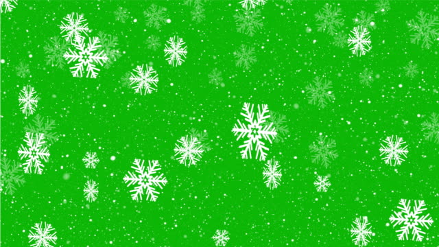 christmas background design of slow motion snowflake and snow falling on green screen - snowflake background stock videos & royalty-free footage