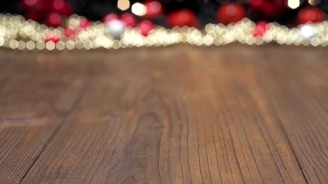 christmas background wooden table , christmas light bokeh - tavolo legno video stock e b–roll