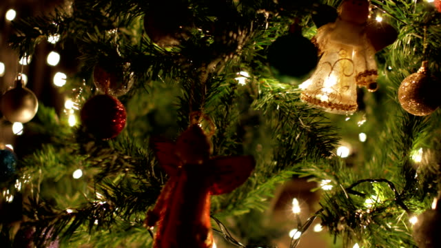 Christmas ball, fairy garland and lights decoration on tree video