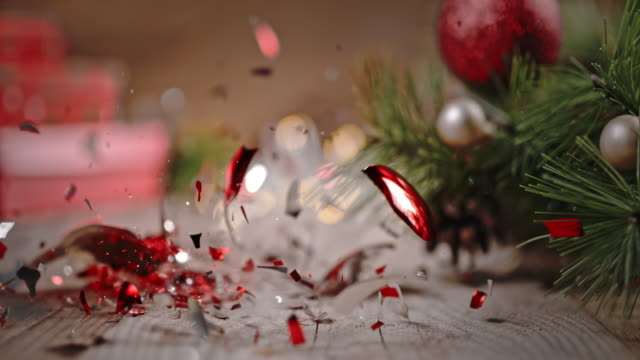 SLO MO Christmas ball falling on the floor, crushed into pieces.