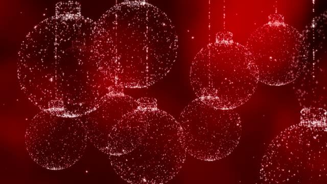 vídeos de stock e filmes b-roll de christmas balls on red background. - christmas card