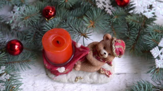 christmas bear candle and decoration with toys. winter holiday