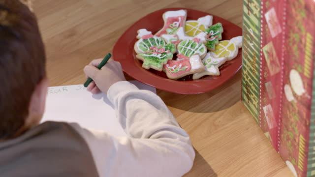Christmas - Boy writes letter to Santa Claus. video