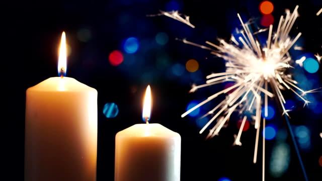 Christmas candles, lit sparkler. HD studio shot video