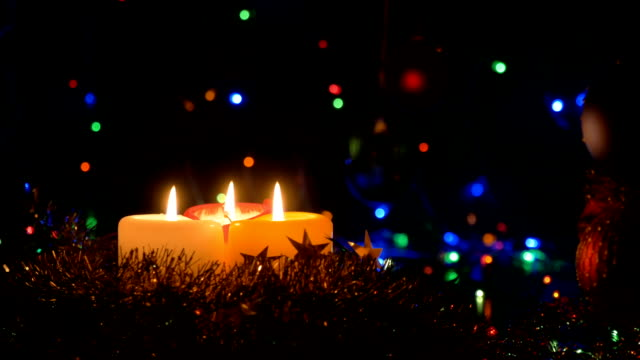 Christmas candles on a dark background. Flashing garlands. video