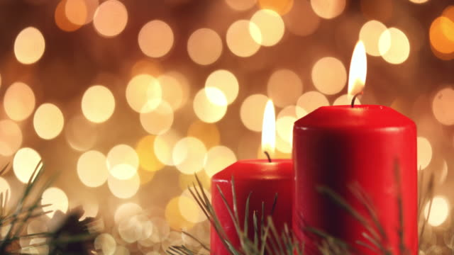 christmas candles on rustic wooden table - treedeo christmas stock videos & royalty-free footage