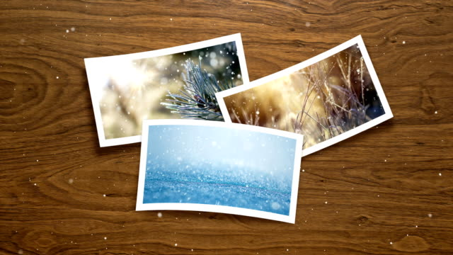 Christmas card - live winter pictures (Loop 4k) Loopable Winter Snow scene on photo frame. polaroid frame stock videos & royalty-free footage