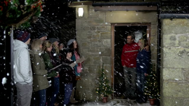 Christmas Carol Singers, singing at a House in the Snow video
