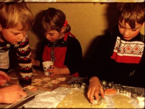 christmas cookies (vintage 8mm film) - videor med baka bildbanksvideor och videomaterial från bakom kulisserna