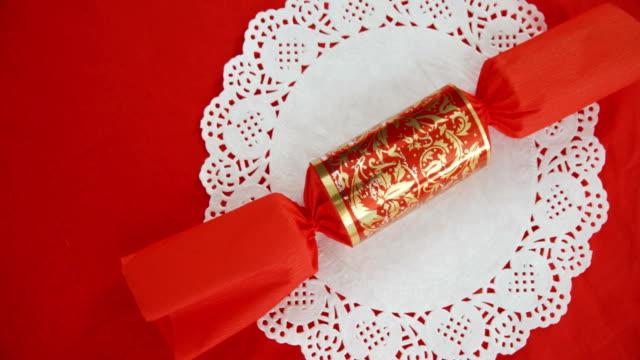 Christmas cracker on table 4k video