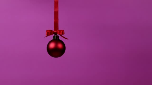 Christmas decoration ball falling from the top of the frame