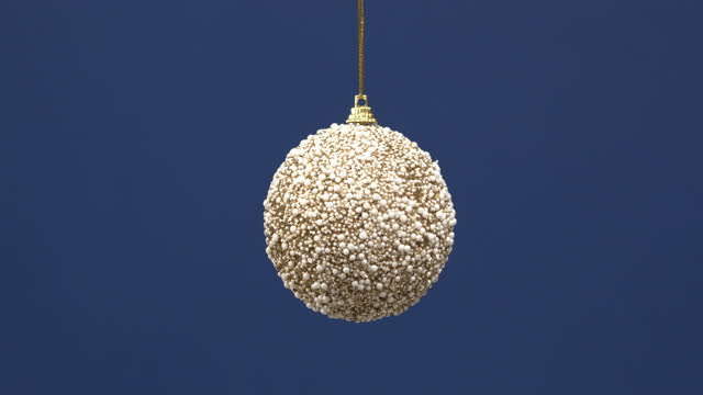 Christmas decoration ball for new year tree hanging on blue background. video