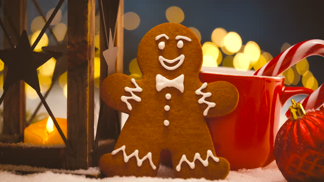 Christmas Decoration on snow with Gingerbread man, Lantern and Christmas lights