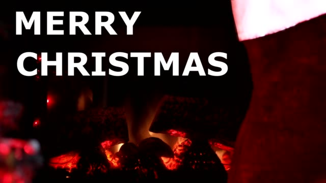 Christmas Fireplace Warm and inviting fireplace at Christmas.  Great holiday feeling with room for your text.  Stocking hangs to right of fireplace.  Text of Merry Christmas Scrolls up during video. christmas stocking stock videos & royalty-free footage