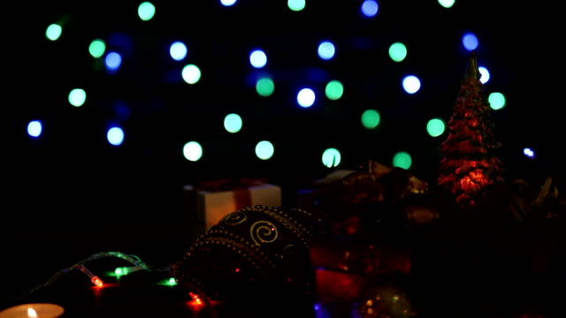 Christmas gift boxes, ball and Christmas tree with colorful blinking bokeh lights video