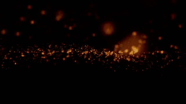 christmas golden light shine particles bokeh loopable on black background, holiday congratulation greeting party happy new year, christmas celebration video