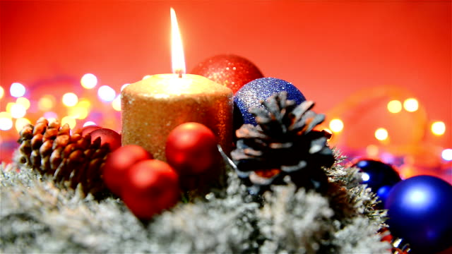 Christmas holiday decoration with candle, baubles and flashing lights video
