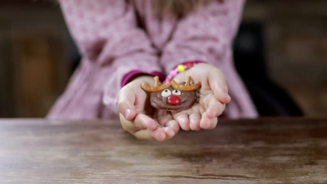 Christmas homemade cookie in child's hands video