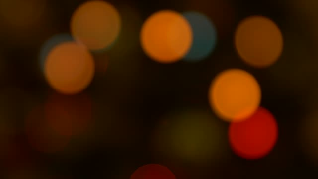 christmas light leaks flashing on decorative garland, blur and bokeh effect - bokeh stock videos & royalty-free footage