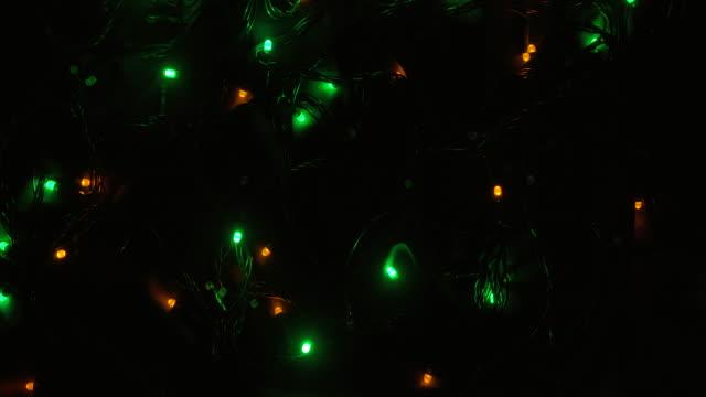 julbelysningen blinkar är färgglad, heminredning - blomsterarrangemang bildbanksvideor och videomaterial från bakom kulisserna