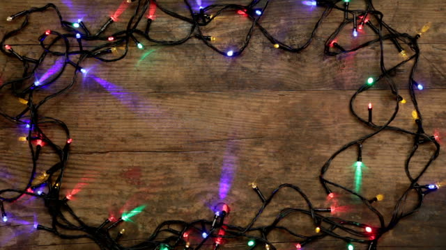 Christmas lights on wooden background video
