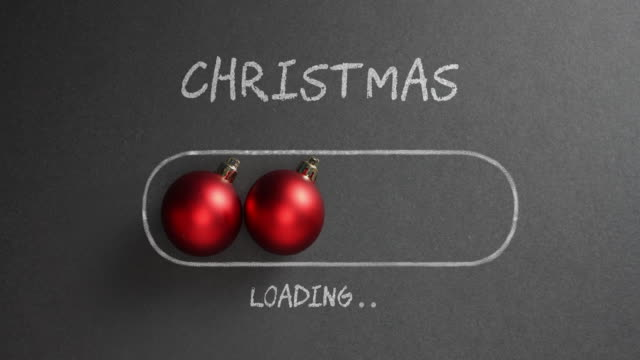 vídeos de stock e filmes b-roll de christmas loading - blackboard holiday decoration red baubles - christmas card