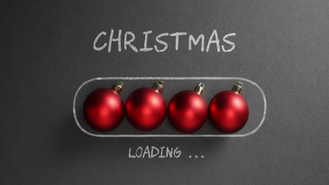 christmas loading - blackboard holiday decoration red baubles - treedeo christmas stock videos & royalty-free footage