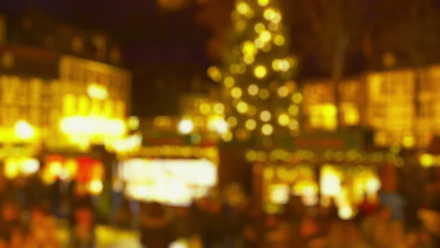 Christmas Market Impressions - Defocused shot of a beautiful Christmas market by night - ProRes video