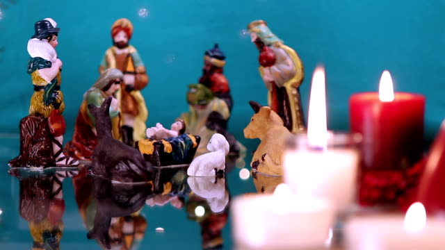 Christmas nativity scene with candles on green video