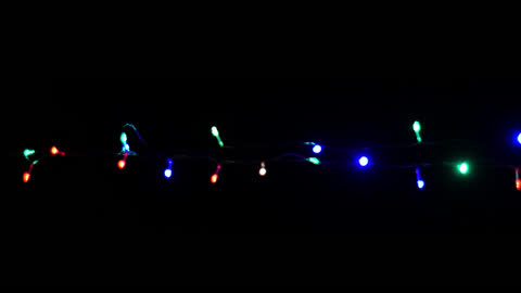 Christmas, New Year blinking LED lights, string, with alpha channel 01 String of Christmas LED lights blinking. Perfect addition for your Christmas, New Year, birthday videos. christmas lights stock videos & royalty-free footage