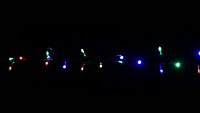 noel, yeni yıl yanıp sönen led ışıkları, dize, alfa kanal 01 ile - christmas lights stok videoları ve detay görüntü çekimi