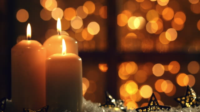 christmas night with lantern and candle - lanterna attrezzatura per illuminazione video stock e b–roll