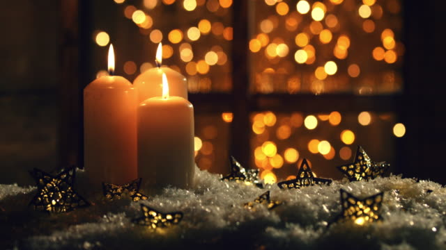 christmas or new year composition with burning candles - christmas decoration стоковые видео и кадры b-roll