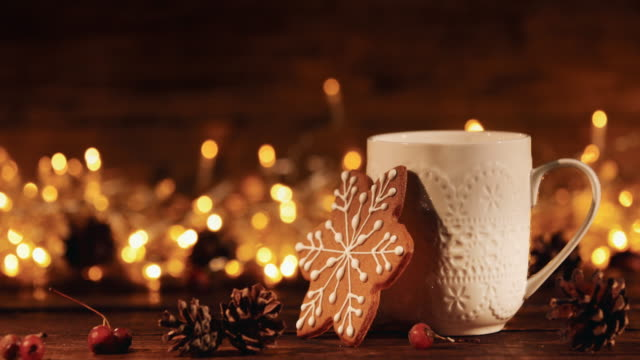 christmas or new year composition with cocoa, gingerbread cookies and christmas decorations - cena di natale video stock e b–roll