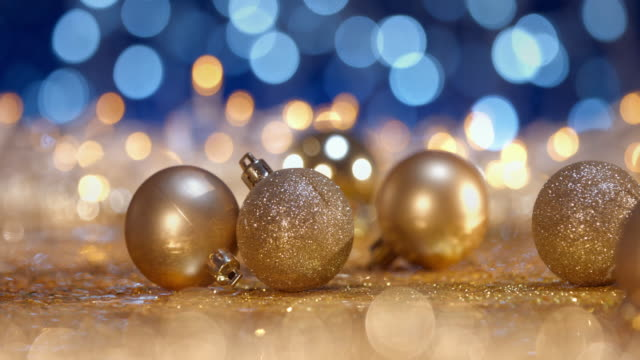 christmas ornament on defocused lights. decorations bokeh blue gold - treedeo christmas stock videos & royalty-free footage