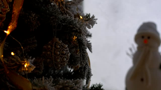 Christmas ornament on tree with bokeh lights. video