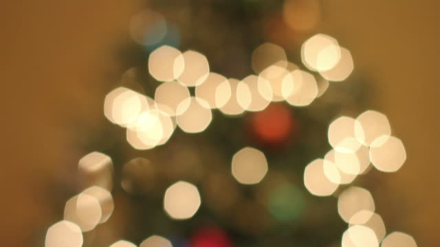 christmas pan from tree to present - tilt down stock videos & royalty-free footage