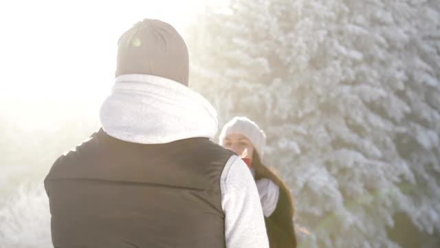 Christmas Present Couple Celebrating Outdoors Joyful Cheer video