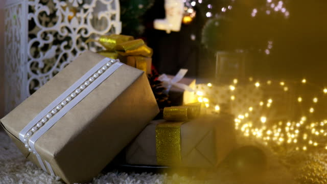 Christmas Presents and Ornaments on Wooden Background video