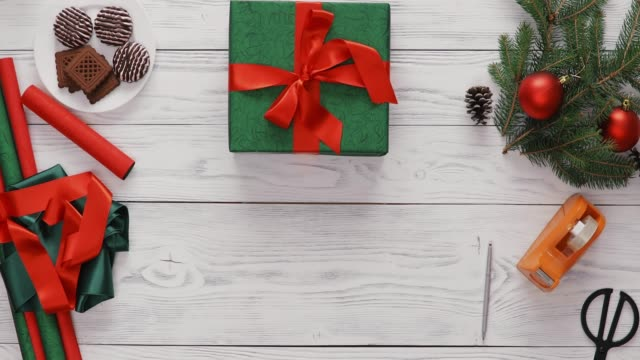 Christmas Presents For The Whole Family, High Angle View Several Beautifully Wrapped Christmas Gifts On The White Rustic Table. Top View Hands Only pine nut stock videos & royalty-free footage
