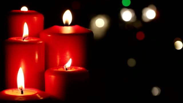 rote kerze weihnachtsdekoration für feier - advent stock-videos und b-roll-filmmaterial