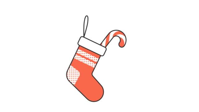 ストライプのお菓子とギフトのクリスマスの赤い靴下 - アイコン プレゼント点の映像素材/bロール