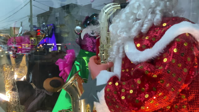 Christmas retail window display decorated with Ded Moroz New Year toys ornaments
