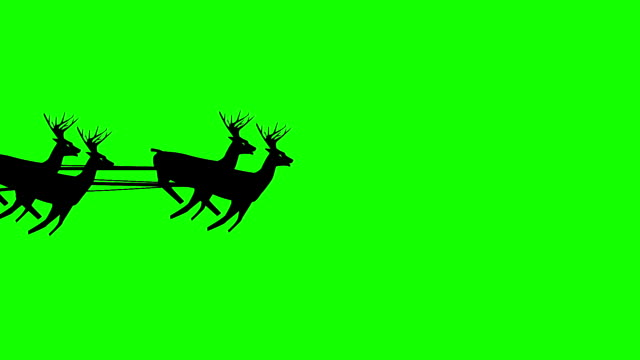 Christmas Santa Claus flying in his sleigh with Christmas gifts pulled by his reindeer. Tiny figure. Silhouette Animation, Looping. Flies through the screen. video