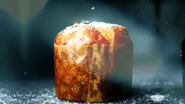 christmas scene of panettone flakes particles light leaks 4k - panettone video stock e b–roll